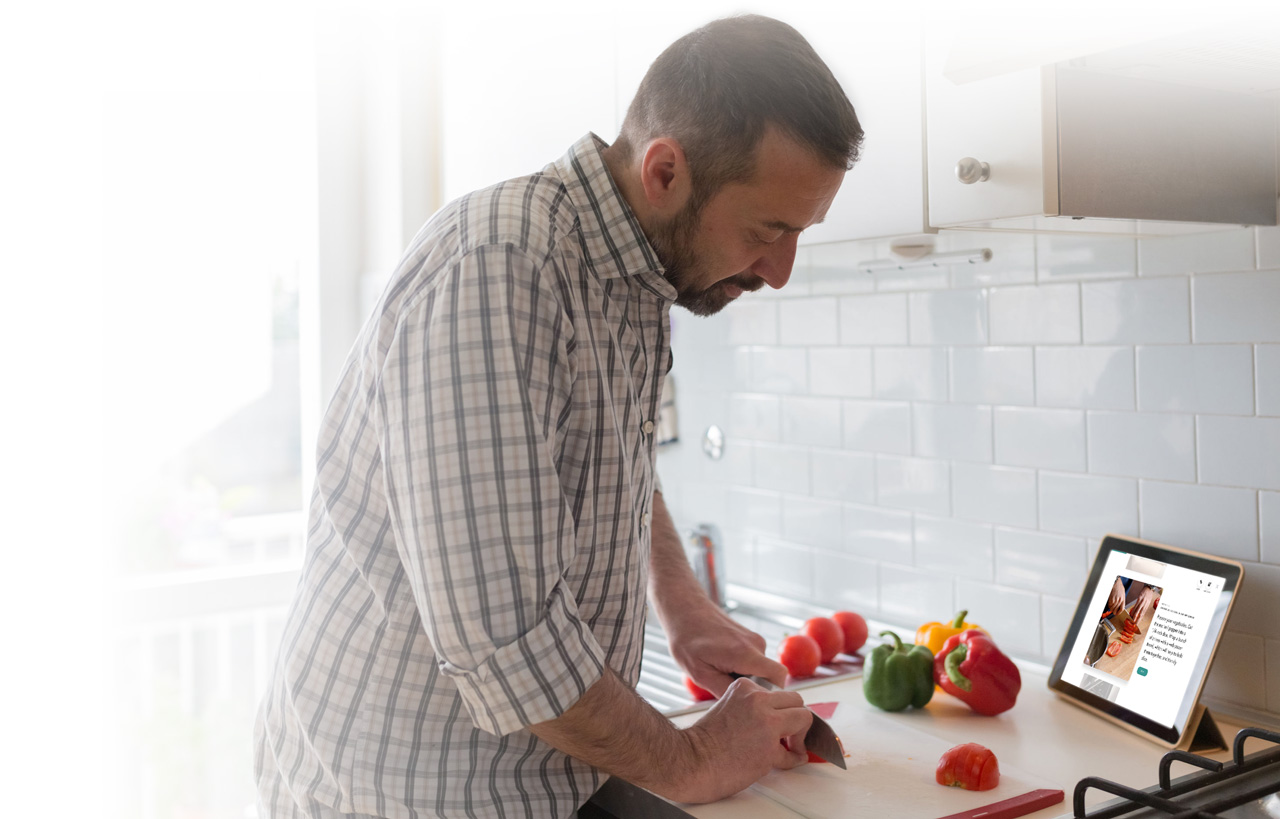 Image of a man using a tablet to make a recipe